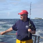 an angler deep in thought at sea