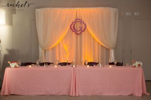 pink draped head table