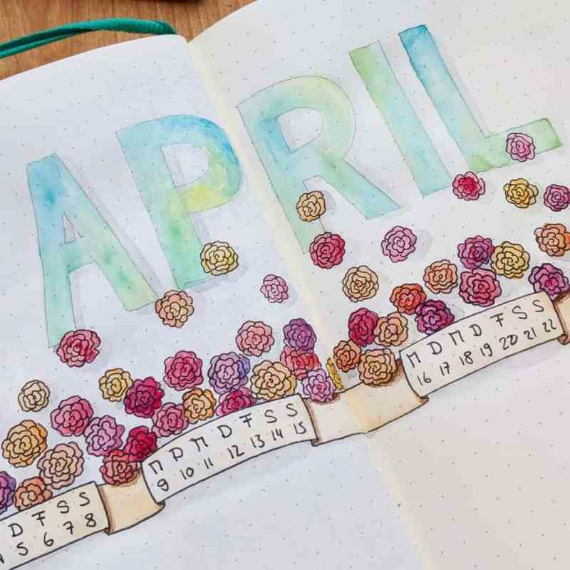 @martinamarion made this great two-page cover page for April This bullet journal cover page spans two pages rather than one. I love the easy flower doodles, especially how the flowers have a dimension with one side colored a little darker than the other. She also included a monthly calendar with this cover page.