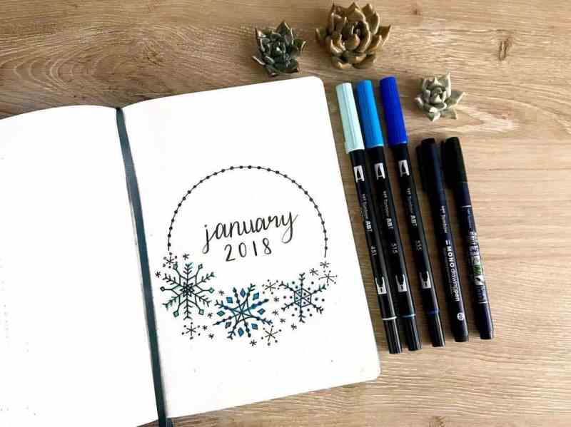 Love this cover page from @bluenittany This bullet journal cover page from my friend Ashlyn is perfect for any winter cover page! I love the use of the Tombow Dual Brush Pens over the black pen on the snowflakes. #bulletjournal