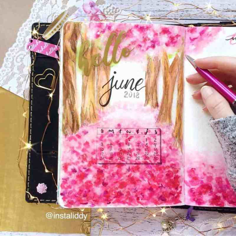 Beautiful forest scene by @instaliddy Here's another flowery forest bullet journal cover page. I love the appearance of cherry blossoms dusting the forest floor. Absolutely brilliant bujo layout, don't you think?