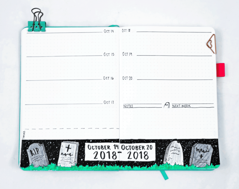 Bullet journal weekly spread with graveyard border at night