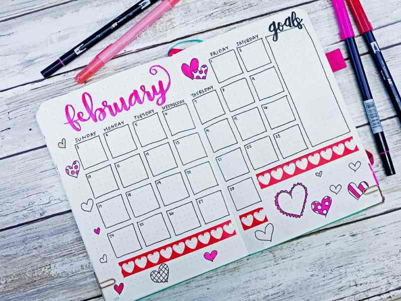Bullet journal monthly calendar with heart doodles and heart washi