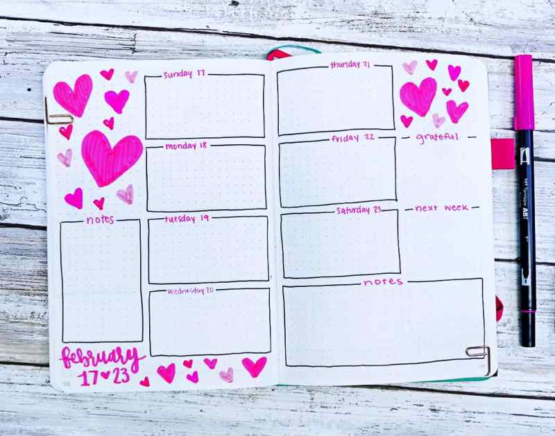 Bullet journal weekly layout for February with lots of heart doodles