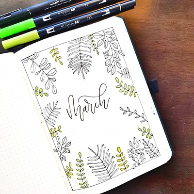 March cover spread with black and green plant theme doodles.