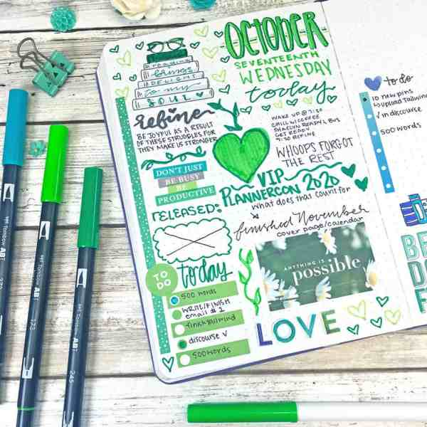 Green bullet journal daily with brush pens