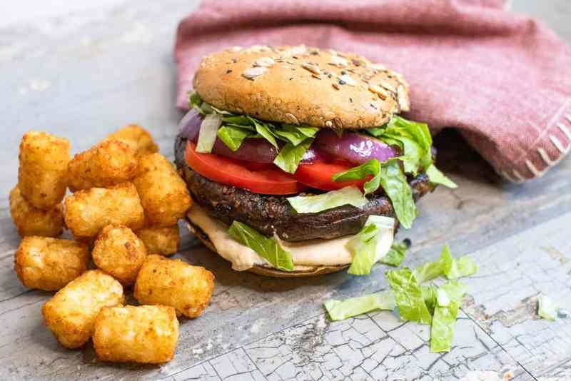 Portobello Mushroom Burger next to tater tots