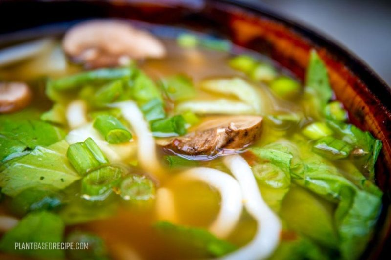 Noodles and vegetables in a flavorful broth.