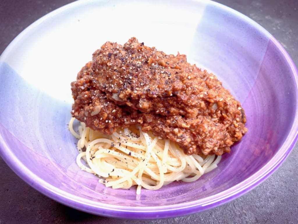 Meaty vegan bolognese sauce in a bowl