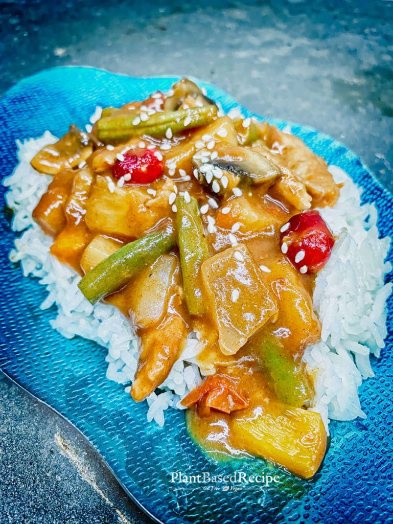 Sweet and sour vegan stir fry served on top of rice.