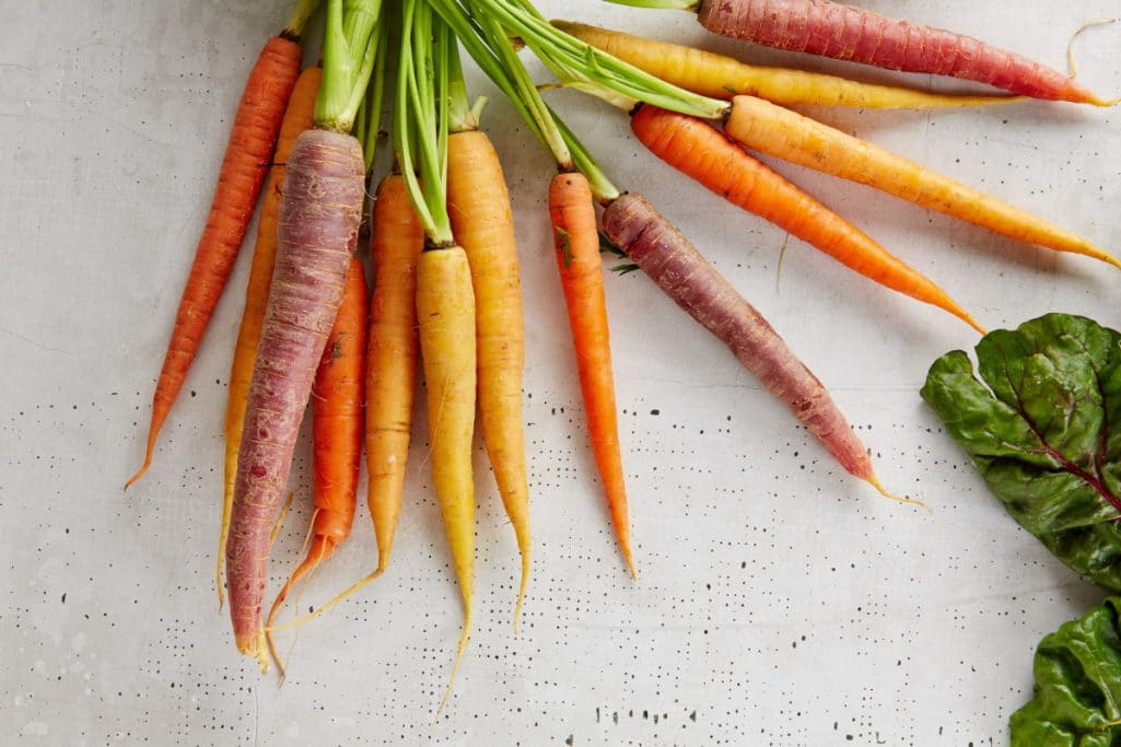Carrots on a table - plant-based foods make up a plant-based diet.