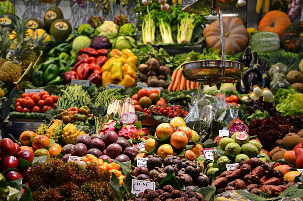Many market vegetables - learn about the definition of plant-based diet.
