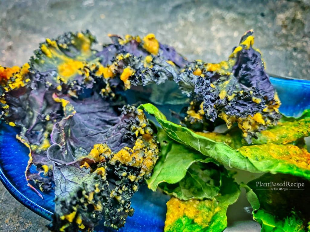 Bright yellow turmeric adds a subtle flavor hint to these cheezy baked kale chips.
