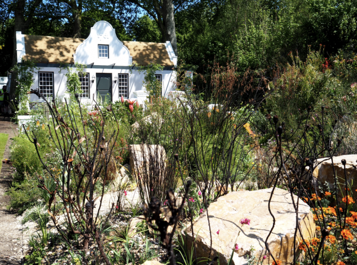 The Trailfinders Garden features a charming Dutch homestead, a richly planted garden and the wild of the fynbos landscape