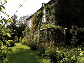 A pergola adding a transition zone, linking the house to the garden