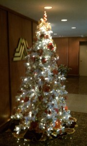 flocked christmas tree with tradional decorations