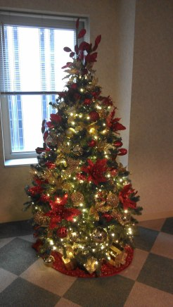 red and gold office christmas tree