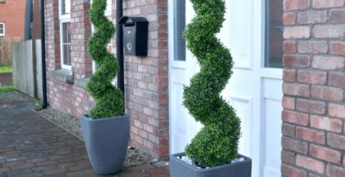 Planted or potted silk spiral trees