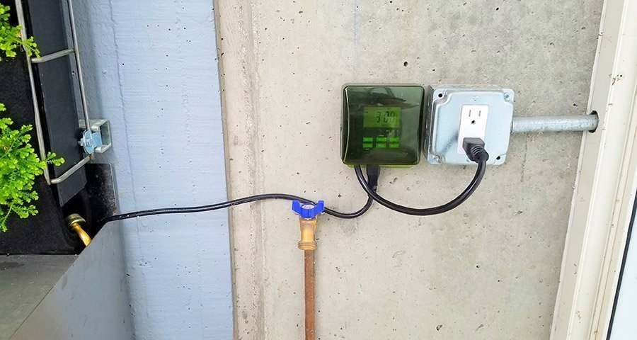 Woods outdoor timer used to operate the pump for the Florafelt Pro System vertical garden at San Francisco Zoo.