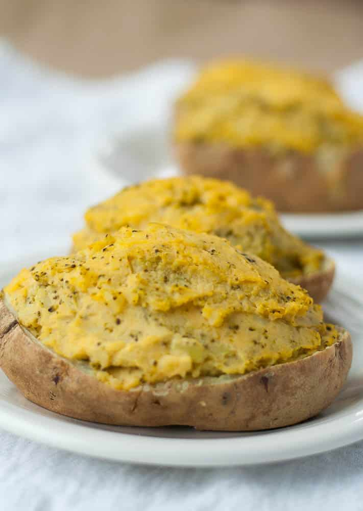 Dairy Free Twice Baked Potato with loads of cheese sauce and broccoli.