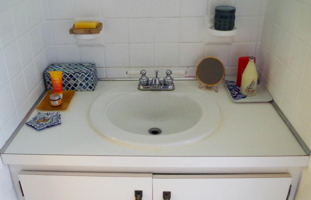 Advice for a sad bathroom vanity - vanity top before - Plaster & Disaster
