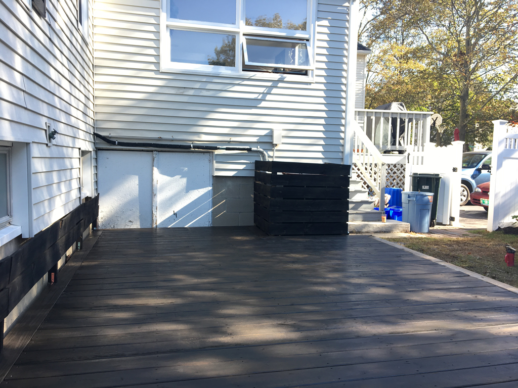 Dark stained deck -- Plaster & Disaster