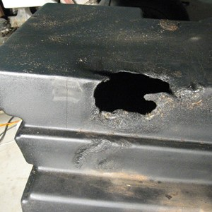 Header fuel tank damaged by fire - before repair