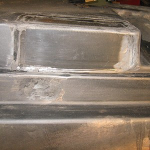 Header fuel tank damaged by fire - repaired