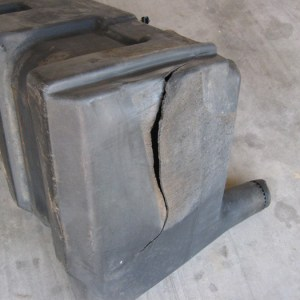 Tractor fuel tank with split