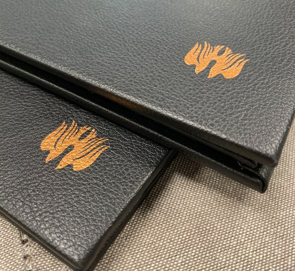 Custom printing and foil stamped in gold on leather menu cover
