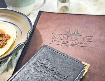 Restaurant logo debossed on menu covers