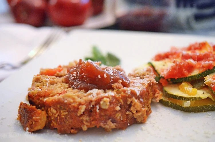 Slice of Apple meatloaf, topped with apple butter.