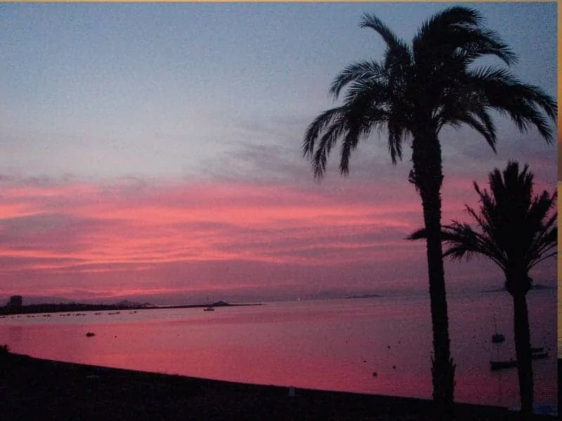 Pink sunset from bedroom window in Playa Honda