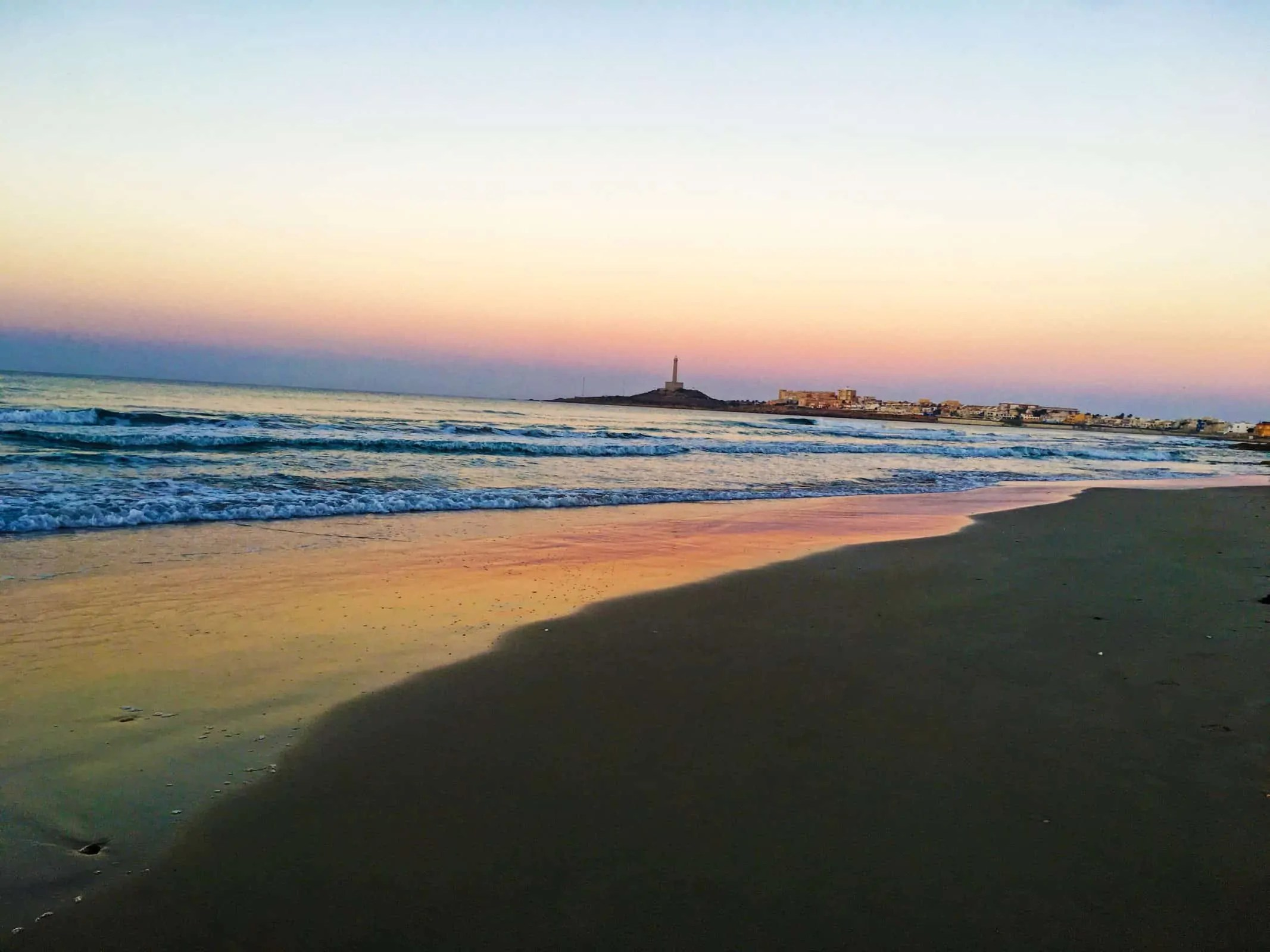 Cabo de Palos beach with the lighthouse in the background