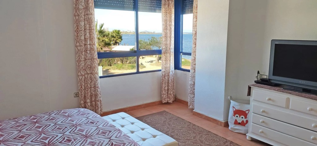 This bedroom has it all - sea views with all the comforts
