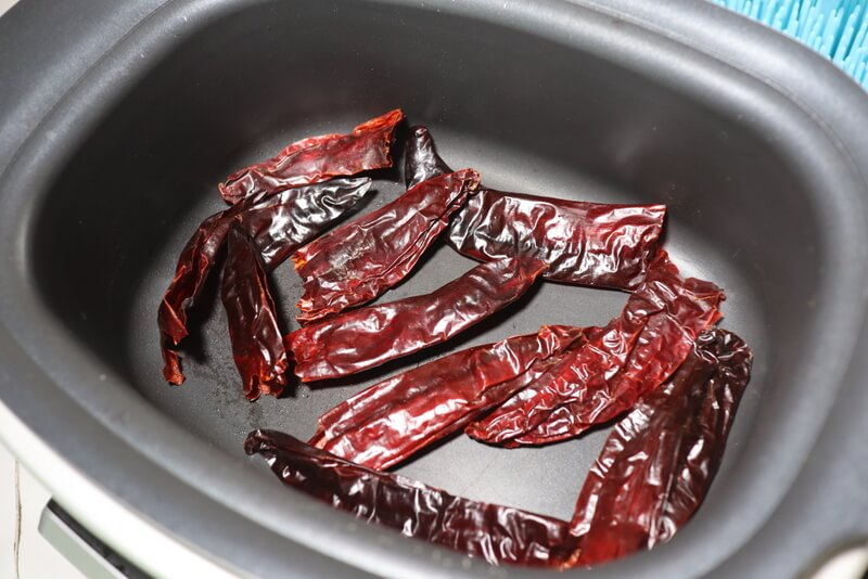 Toasting chile guajillos for gluten free enchiladas