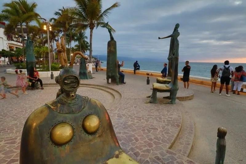 Puerto Vallarta beach board walk surrealist sculptures at sunset