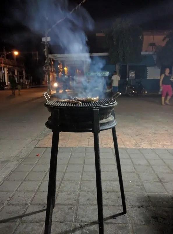 Grilling asada for tacos in Cuyutlan, Colima