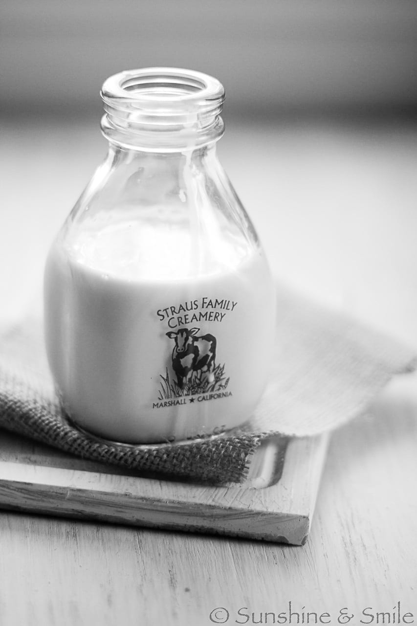 black and white photo of straus family creamery bottle