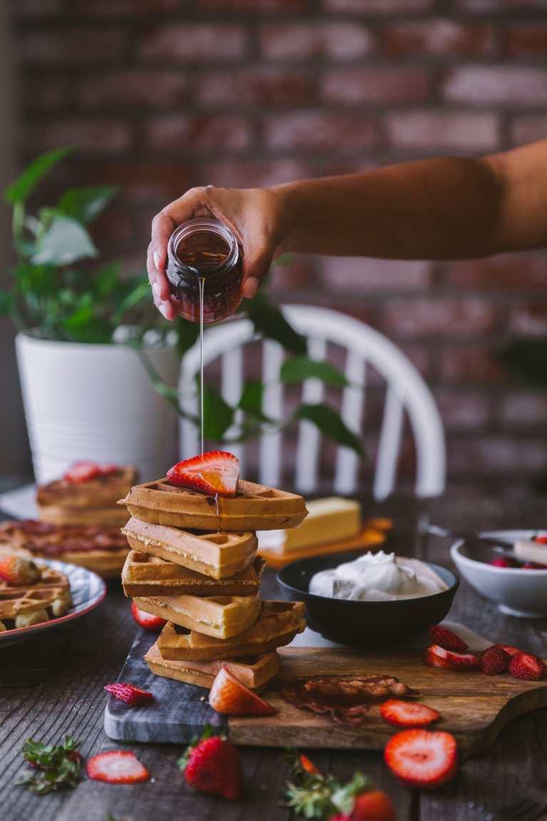Sprinkle syrup on belgian waffle