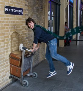 Harry passes through the wall to platform nine and three quarters