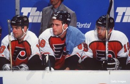 """23 APR 1995: PHILADELPHIA FLYERS """"LEGION OF DOOM"""" LINE, LEFT TO RIGHT: JOHN LECLAIR, ERIC LINDROS, MIKAEL RENBERG, ON THE BENCH DURING A 4-2 LOSS TO THE BUFFALO SABRES AT THE MEMORIAL AUDITORIUM IN BUFFALO, NEW YORK. Mandatory Credit: Harry Scull/ALLSPOR"""