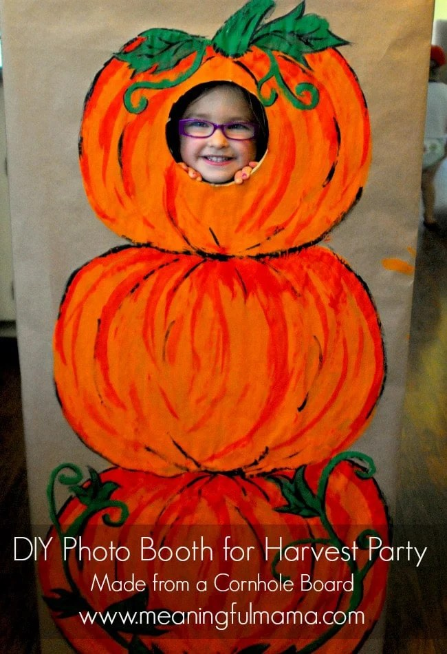 Skip the fall party games and do this pumpkin photo booth instead