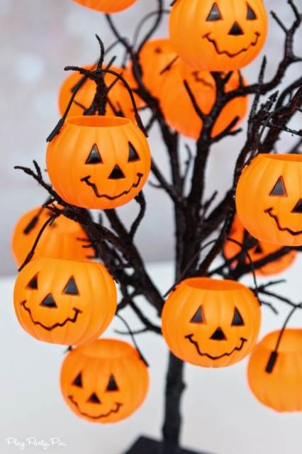 Kids will love this Halloween party game idea where they pick a pumpkin with a trick or treat inside