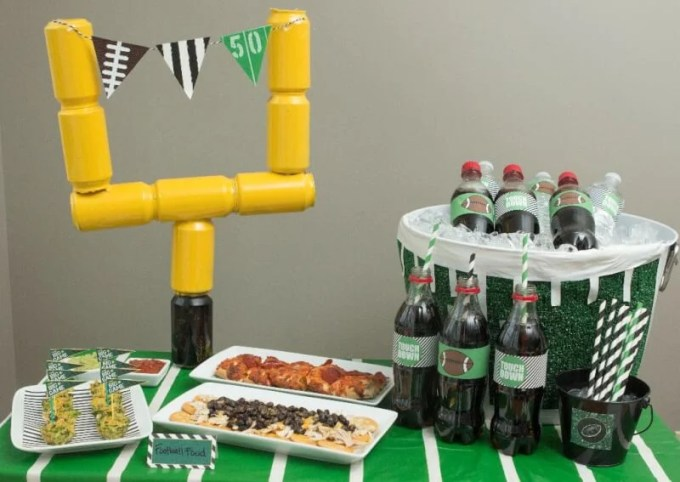 Great tutorials for DIY football party decor like the DIY field goal post and football field beverage bucket