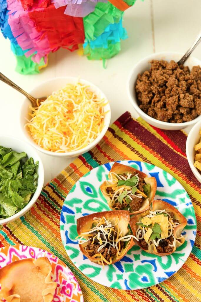 """These taco salad bites look amazing, perfect for parties, bridal showers, or even baby showers! Make little crispy """"taco"""" shells in a muffin tin and fill with taco salad toppings!"""