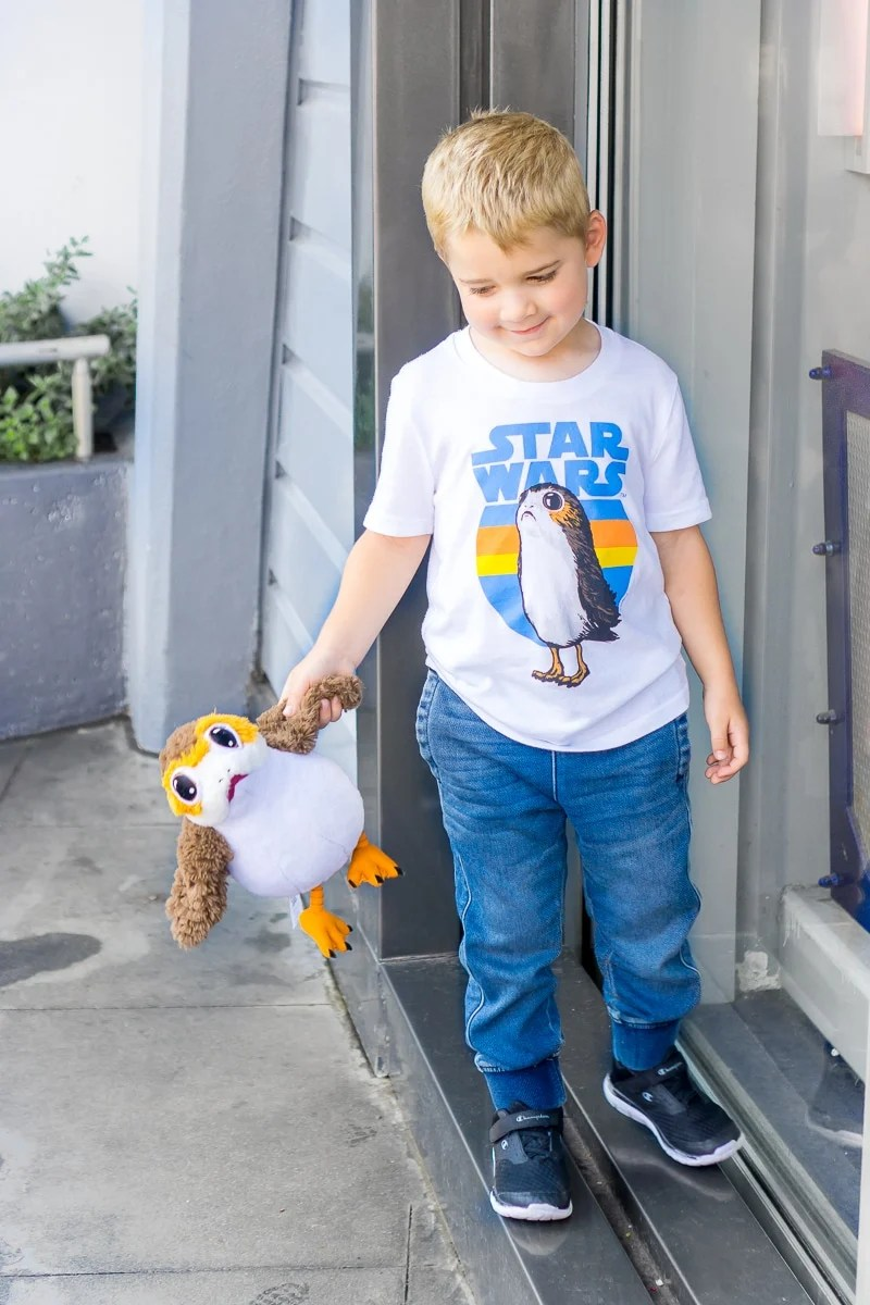 Kid holding Porg while getting ready for kindergarten