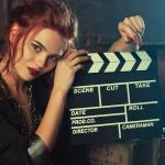A girl with clapperboard