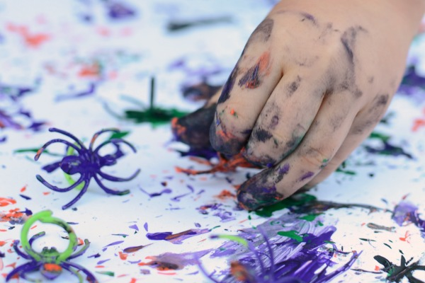 Play with spider rings -- use them for some Halloween painting fun!