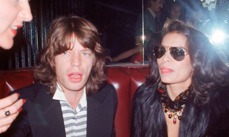 Mick and Bianca Jagger out on the town, 1982